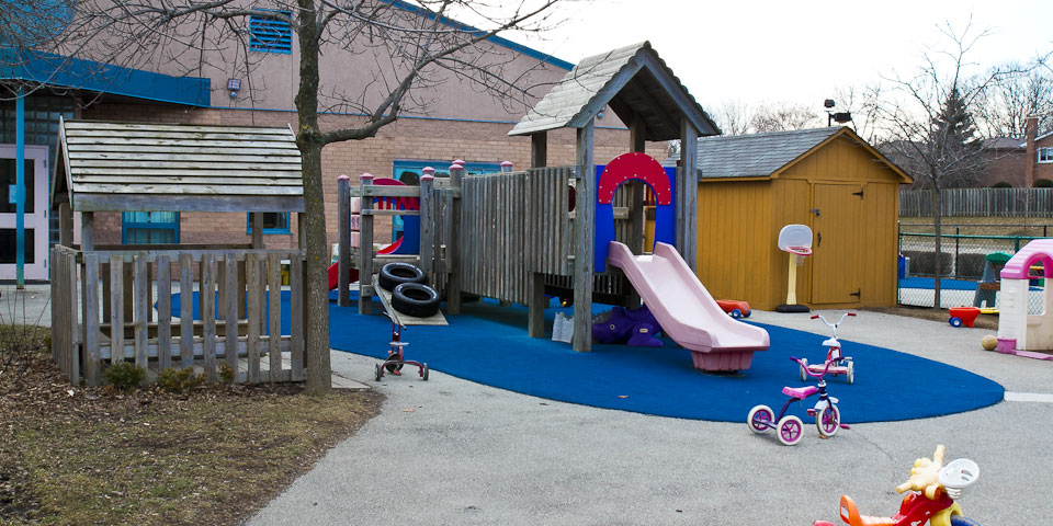 Eden Daycare playground with gazebo and climber
