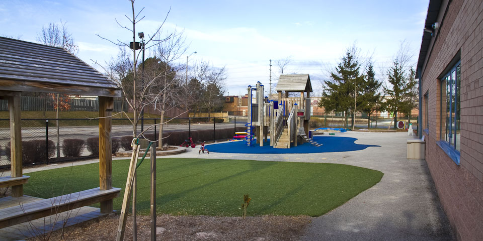 Eden Daycare side playground with gazebo and climber